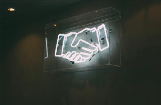Neon handshake sign