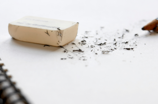 Eraser on notebook: content marketing mistakes to avoid