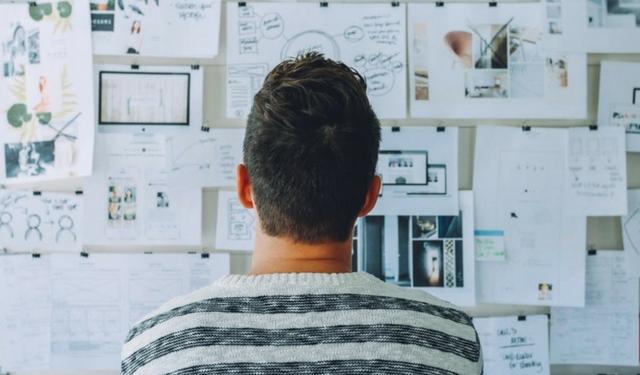 Man staring at whiteboard