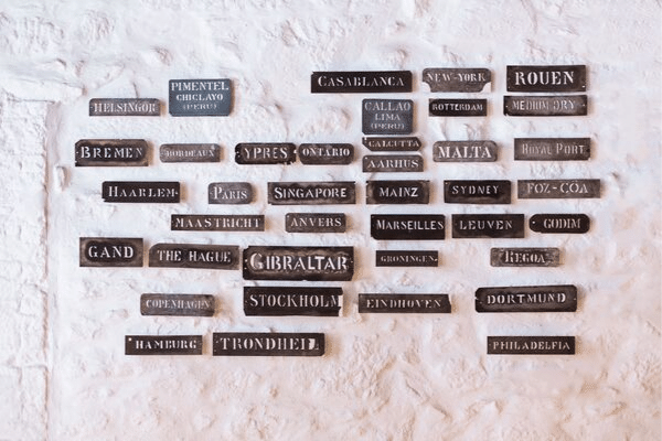 Different cities on plaques, different writing styles