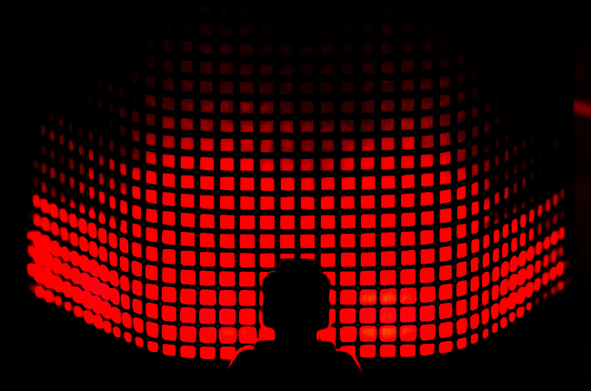 Machine in front of red lights