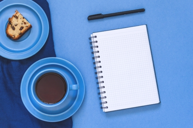 white notepad on blue table