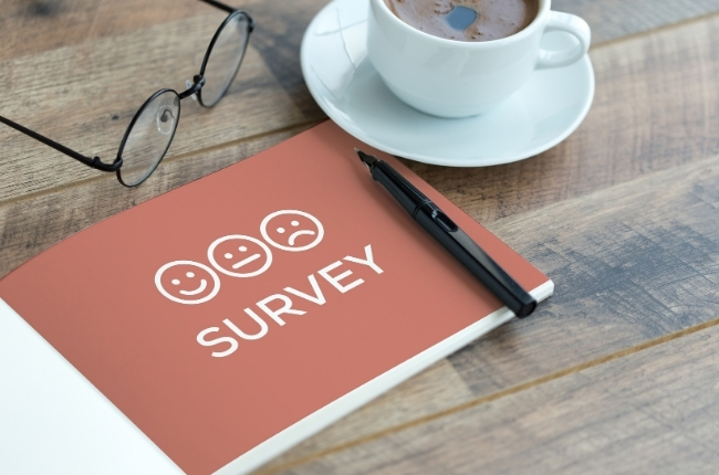 survey book on a wooden table