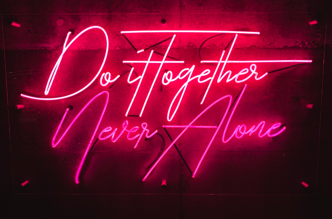 """Neon sign """"Do it together, Never alone"""""""