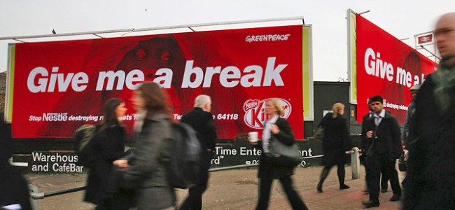 """Billboards with image of orangutan and words """"Give me a break"""""""
