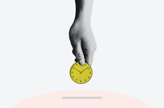 Hand holding a yellow clock