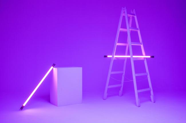 Purple neon-lit ladder and block