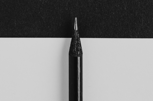 Black pencil on black and white paper