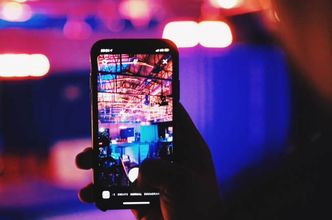 Person taking Instagram Story of event