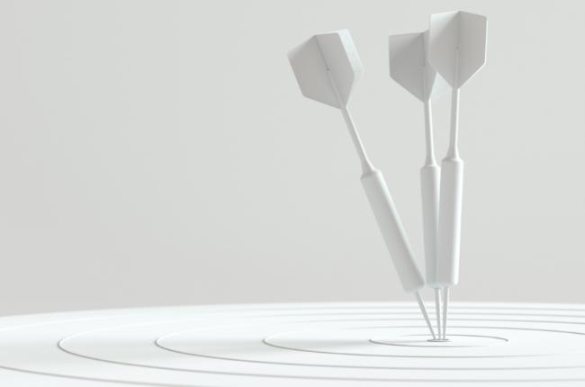 Minimal white target and darts